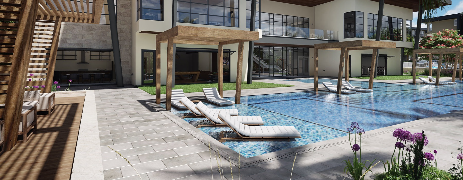 Spacious sparkling pool with sundecks and cabanas for lounging.